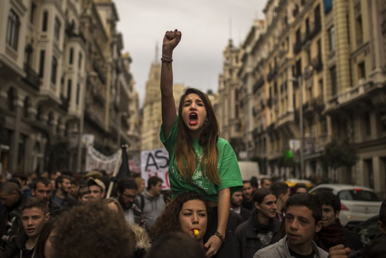 Students shout slogans as they march during the second day of a student's strike in Madrid, Spain Thursday Feb. 26, 2015. Students across Spain are protesting changes in the system of university degrees with protests and a two-day strike. (Andres Kudacki/AP Photo)