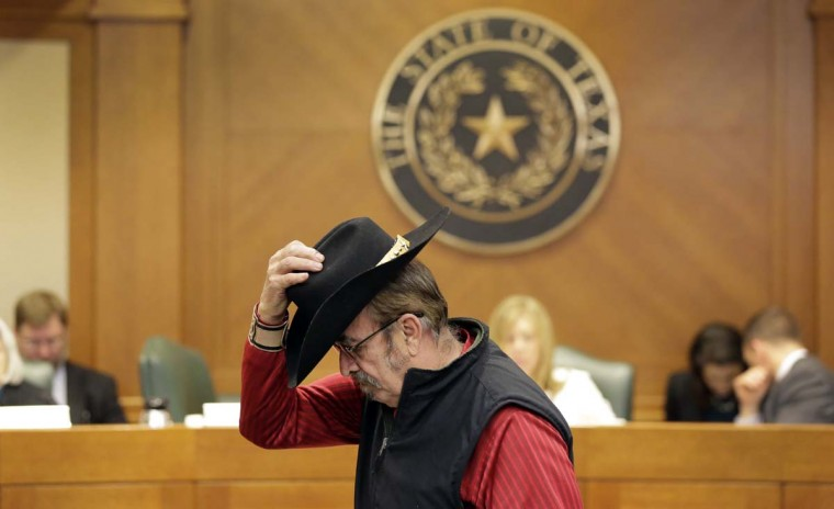 Jerry Williams replaces his hat after giving testimony at a hearing where lawmakers discuss whether to legalize concealed handguns on college campuses and open carry everywhere, Thursday, Feb. 12, 2015, in Austin, Texas. More than 100 people waited under heightened security at the Capitol to testify on looser firearm laws that Republicans have prioritized under new Gov. Greg Abbott.     CREDIT: ERIC GAY - AP PHOTO