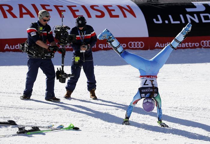 Slovenia's Tina Maze does a cartwheel after finishing her run during the women's alpine slalom competition at the alpine skiing world championships Monday in Beaver Creek, Colo. (Marco Trovati/AP)