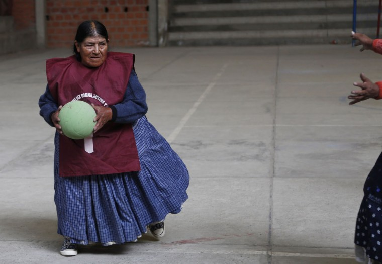 In this Jan. 28, 2105 photo, Rosa Lima plays handball with other elderly Aymara indigenous women in El Alto, Bolivia. ìThere are days my knees hurt from rheumatism, but when I play it goes away,î said 77-year-old Lima, who first began doing simple exercises eight years ago, then later took up team handball. She lives alone and looks forward to playing with her friends every week. (AP Photo/Juan Karita)