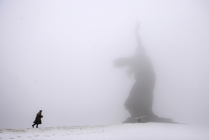 In this Feb. 2 photo a man dressed in Red Army World War II uniform walks toward the monument to Motherland during ceremonies marking the 72nd anniversary of the Battle of Stalingrad in the southern Russian city of Volgograd, once known as Stalingrad. (Dmitry Rogulin/AP)