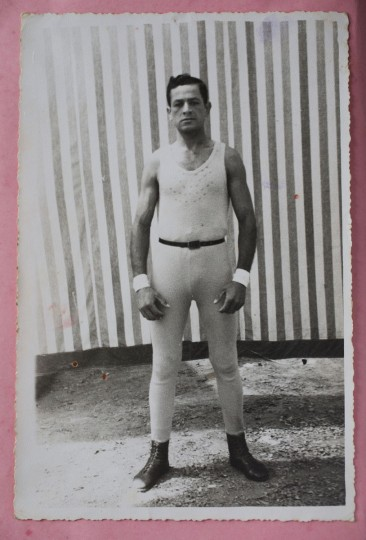 "A photograph of Ricardo Farfan shows him as a performer in 1954 at his father's circus, the Farfan Brothers Circus, in Peru. Farfan worked at the circus as a trapeze artist, contortionist, balancing actor, stilt walker, magician, as well as electrician and painter, but became best known as ""Pitito"" the clown. (AP Photo/Esteban Felix)"