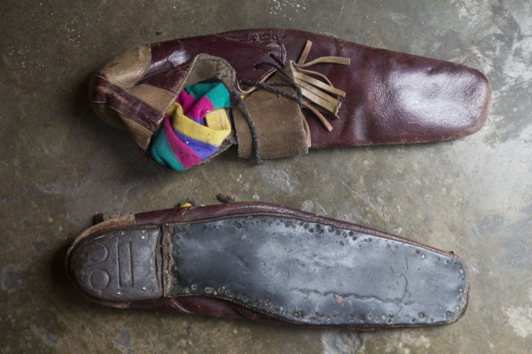 "A pair of clown shoes belonging to veteran clown Ricardo Farfan, popularly known as ""Pitito,"" sit in his home in Lima, Peru. Farfan, who started working at his father's circus when he was three-years-old in 1927, says his children wish he would retire, but he said he does it for the joy of practicing his craft and will do so until he dies. (AP Photo/Esteban Felix)"