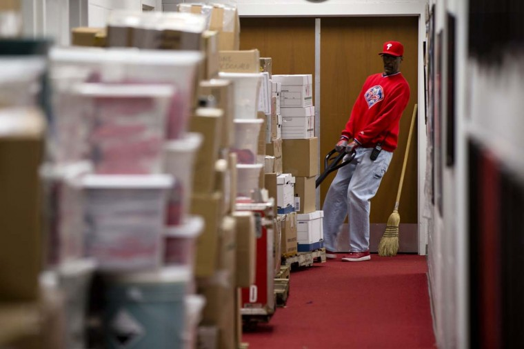 A workman packs up Philadelphia Phillies baseball equipment for a trip to the teams spring training site in Clearwater, Fla., Friday, Feb. 13, 2015, in Philadelphia.     CREDIT: MATT ROURKE - AP PHOTO