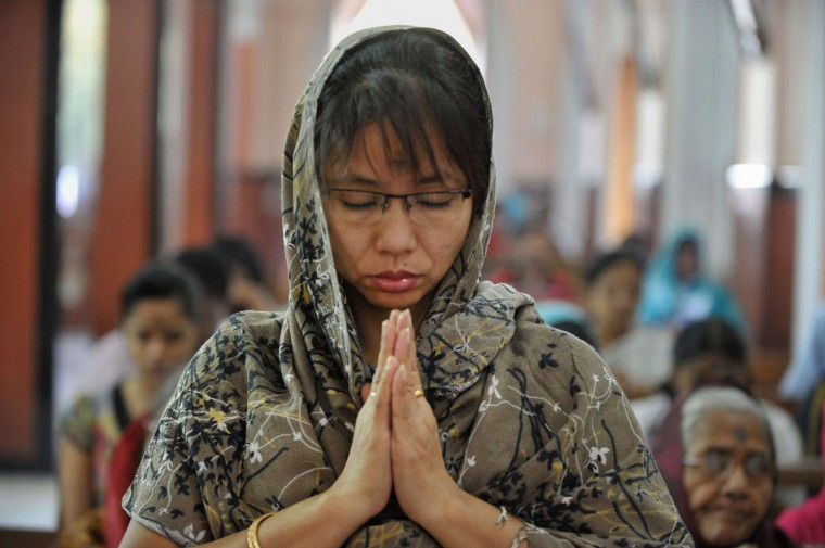 Indian Catholic Christians offer prayers during an Ash Wednesday service at Saint Mary's Basilica in Secunderabad, the twin city of Hyderabad, on February 18, 2015. (NOAH SEELAM/AFP/Getty Images)