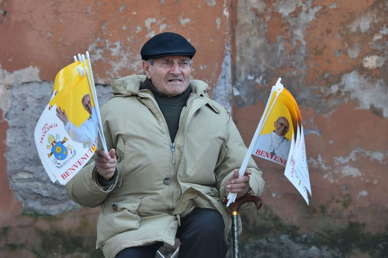 A man sells Vatican flags outside the Santa Sabina church before the Ash Wednesday mass opening Lent, the forty-day period of abstinence and deprivation for Christians, before Holy Week and Easter on February 18, 2015 in Rome. (GABRIEL BOUYS/AFP/Getty Images)