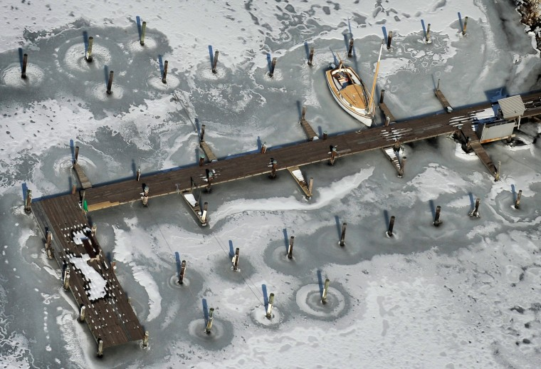 A docked sailboat is surrounded by ice near Kent Island in the Chesapeake Bay. (Lloyd Fox/Baltimore Sun)