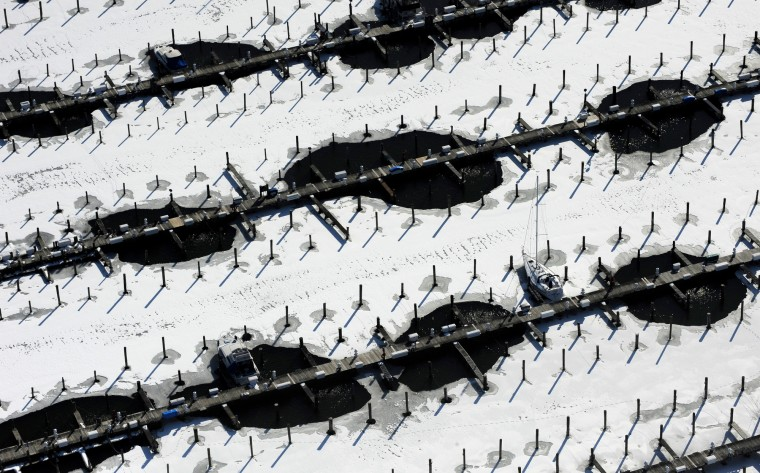 Ice surrounds the docks at a MIddle River marina, where a few boats remain moored. (Lloyd Fox/Baltimore Sun)