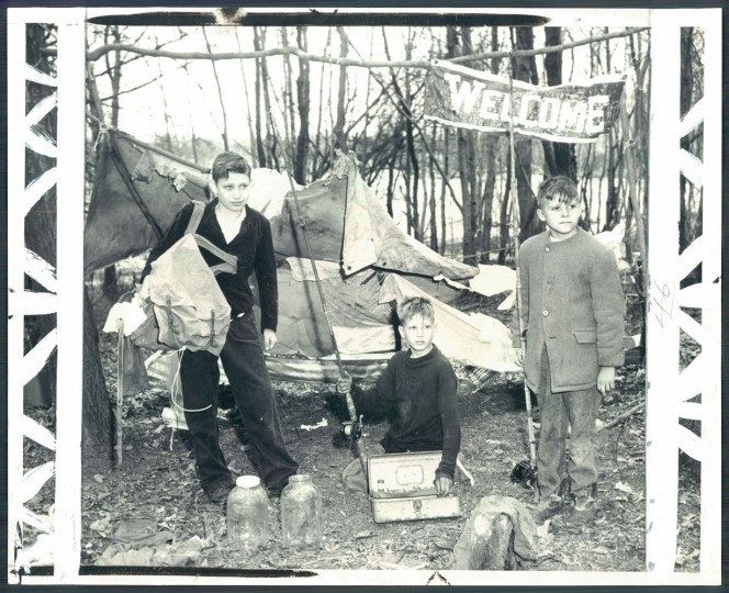 March 30, 1960: With spring in the air these boys took off for the wide-open spaces of Anne Arundel county and set up this camp in a woods near their homes in the 200 block of Werner road. The boys, Silas Hess, 12, left, James Honaker, 12, center, and Danny Honaker, 11, went into hiding Monday and did not return to their homes until today, tire, but happy. Photo by William Klender
