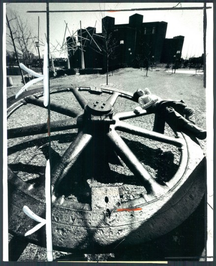 April 2, 1980: Mary Mayfield finds an old cable car wheel in inner harbor just the spot for a sun bath. Photo by George H. Cook.