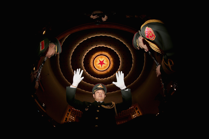 A conductor of a military band performs during a rehearsal before the opening session of the Chinese People's Political Consultative Conference at the Great Hall of the People on Tuesday in Beijing, China. Over 2,000 members of the 12th National Committee of the Chinese People's Political Consultative, a political advisory body, are attending the annual session, during which they will discuss the development of China. (Feng Li/Getty Images) Editor's note: Image was created using a fisheye lens.