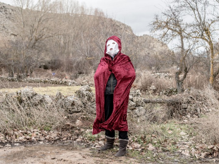 A woman wearing a mask poses for a portrait as she takes part in a carnival in the village of Luzon on Feb. 14 near Molina de Aragon, Spain. (David Ramos/Getty Images)