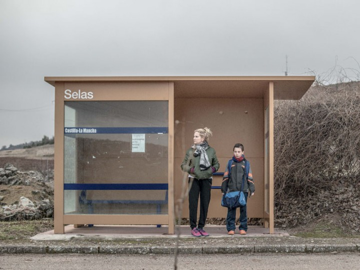 Mari Angeles Moreno, 44, and her son Juan Romero, 11, wait for the school bus outside the village of Selas on Feb. 23 near Molina de Aragon, Spain. Juan is the only boy in the village of Selas. The school in Selas was shut down in 1974 and moved to Molina de Aragon, the biggest village in the region. Juan travels more than 40 miles every weekday to go to school. (David Ramos/Getty Images)