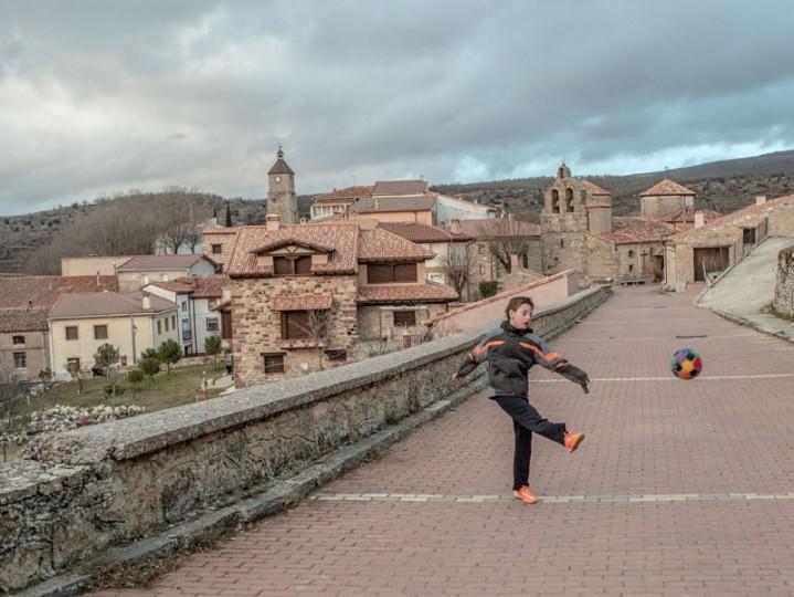 Juan Romero, 11, kicks a ball against a wall in the village of Selas on Feb. 24 near Molina de Aragon, Spain. (David Ramos/Getty Images)