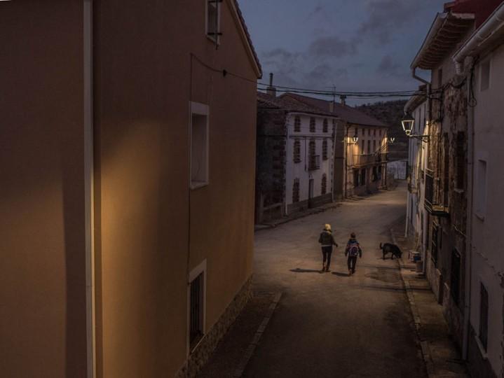 Mari Angeles Moreno, 44, and her son Juan Romero, 11, walk along a empty street in the village of Selas on Feb. 24 near Molina de Aragon, Spain. (David Ramos/Getty Images)