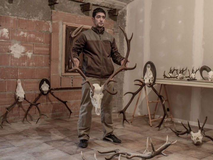 David Oter, 21, holds a dried head of deer as he poses for a portrait in Castilnuevo on Feb. 25 near Molina de Aragon, Spain. The economic crisis has forced Oter, an unemployed electrician, and many others to emigrate or look for new jobs. Oter has worked as a taxidermist since 2013. (David Ramos/Getty Images)