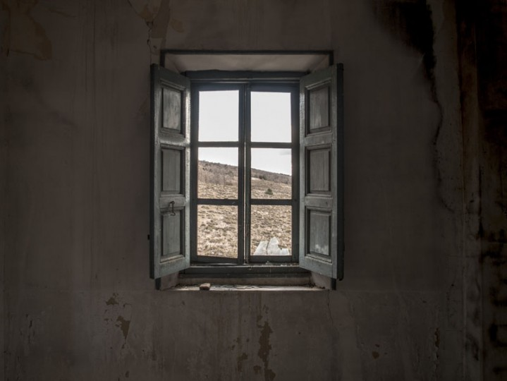 The landscape is seen through the window of an abandoned house in the village of Selas on Feb. 26 near Molina de Aragon, Spain. (David Ramos/Getty Images)