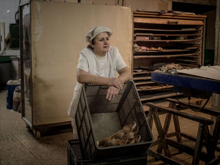 Martina Mateo, 54, looks on as she has a break from making bread at her bakery in the village of the Rillo de Gallo on Feb. 25 near Molina de Aragon, Spain. (David Ramos/Getty Images)