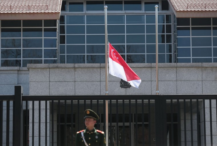 The Singaporean national flag flies at half-mast at Embassy of The Republic of Singapore on March 23, 2015 in Beijing, China. Lee Kuan Yew, former Prime Minister of Singapore, died at the age of 91 at Singapore General Hospital on Monday morning. (Photo by ChinaFotoPress/Getty Images)
