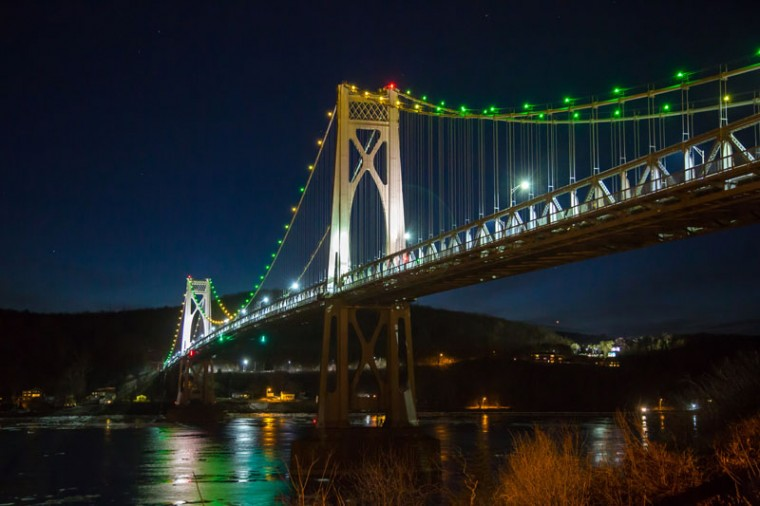 The Mid-Hudson Bridge is illuminated to shine light on the Ebola crisis and show solidarity with West Africa as part of the #TackleEbola campaign on Monday in Poughkeepsie, New York. (Kenneth Gabrielsen/Getty Images)