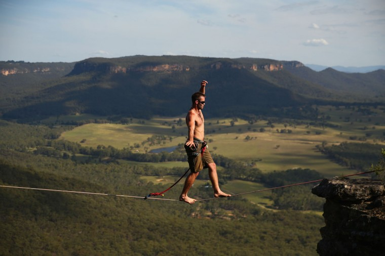 Tim Desmond of Australia walks a highline at Corroboree Walls in Mount Victoria on March 8, 2015 in the Blue Mountains, Australia. (Photo by Cameron Spencer/Getty Images)