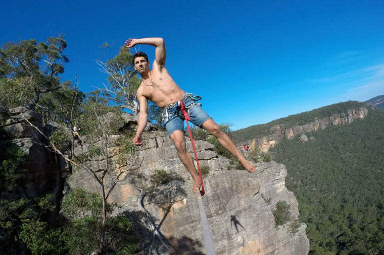Matt Macelli of Australia balances on a highline rigged between cliffs at Corroboree Walls in Mount Victoria on March 8, 2015 in the Blue Mountains, Australia. (Photo by Cameron Spencer/Getty Images)