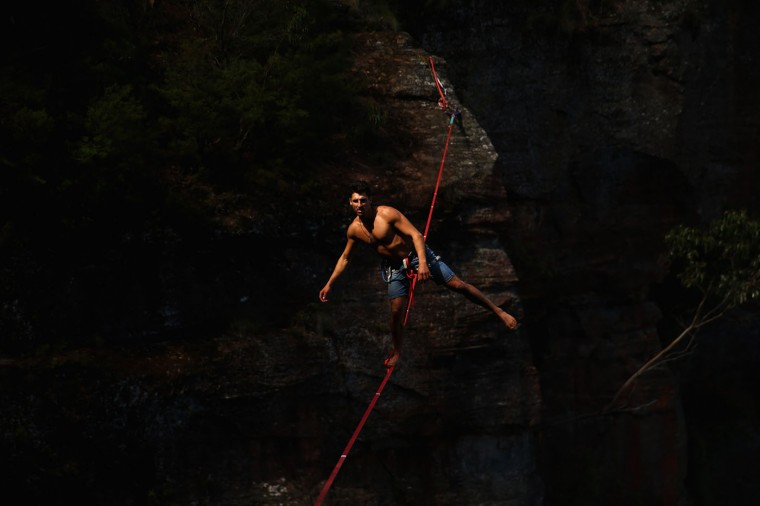 Matt Macelli of Australia walks on a highline rigged between cliffs at Corroboree Walls in Mount Victoria on March 7, 2015 in the Blue Mountains, Australia. (Photo by Cameron Spencer/Getty Images)