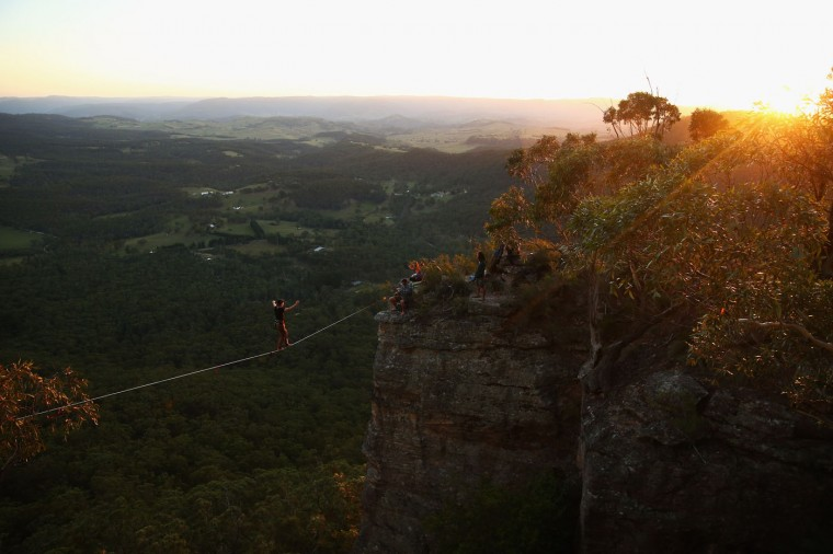 Quirin Herterich of Germany walks on a highline rigged between cliffs at Corroboree Walls in Mount Victoria on March 6, 2015 in the Blue Mountains, Australia.(Photo by Cameron Spencer/Getty Images)