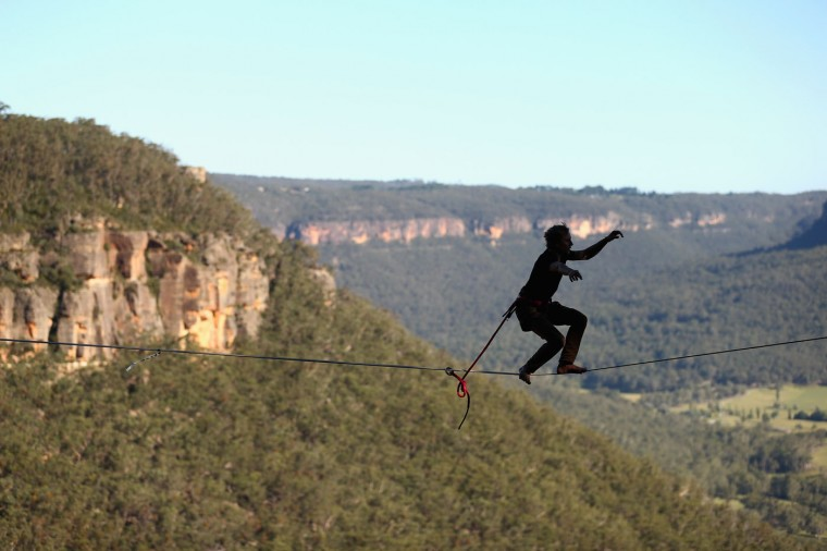 Quirin Herterich of Germany walks on a highline rigged between cliffs at Corroboree Walls in Mount Victoria on March 6, 2015 in the Blue Mountains, Australia. (Photo by Cameron Spencer/Getty Images)