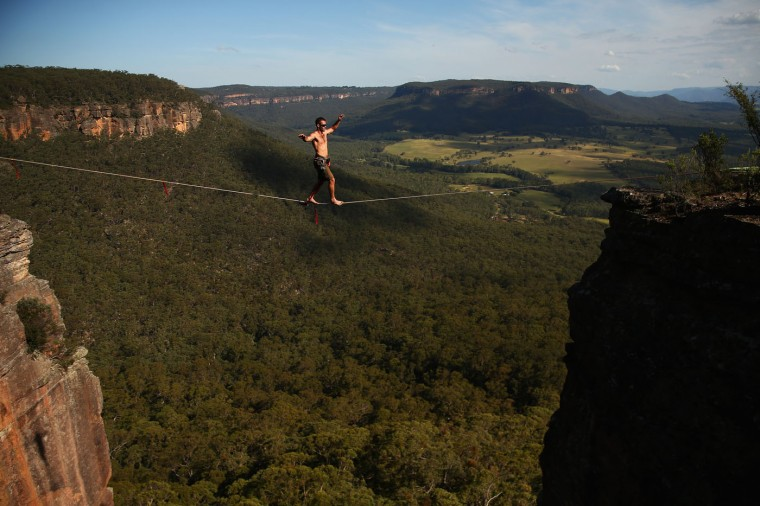 Tim Desmond of Australia walks a highline rigged between cliffs at Corroboree Walls in Mount Victoria on March 7, 2015 in the Blue Mountains, Australia. (Photo by Cameron Spencer/Getty Images)
