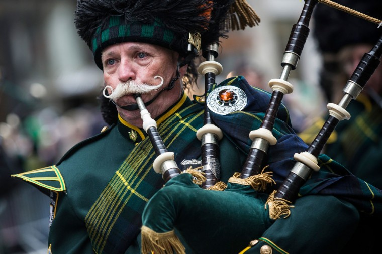 A bagpiper marches in the annual St. Patrick's Day Parade along Fifth Ave in Manhattan on March 17, 2014 in New York City. Political controversy surrounded this year's parade, as New York City Mayor Bill De Blasio decided not to march due to the parade organizer's policy to ban participants that identify themselves as lesbian, gay, bisexual or transgender. Heineken and Guinness announced earlier that they would drop their sponsorship of the parade for along the same reasons. (Photo by Andrew Burton/Getty Images)