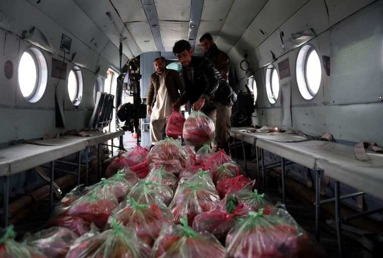 Afghan army personnel load emergency food supplies into a helicopter to be delivered to avalanche survivors in Panjshir province north of Kabul on March 1, 2015. Afghan President Ashraf Ghani February 28 pledged to set up a relief fund for the victims of avalanches that claimed over 280 lives, and called for international help with the relief effort. (Shah Marai/AFP/Getty Images)