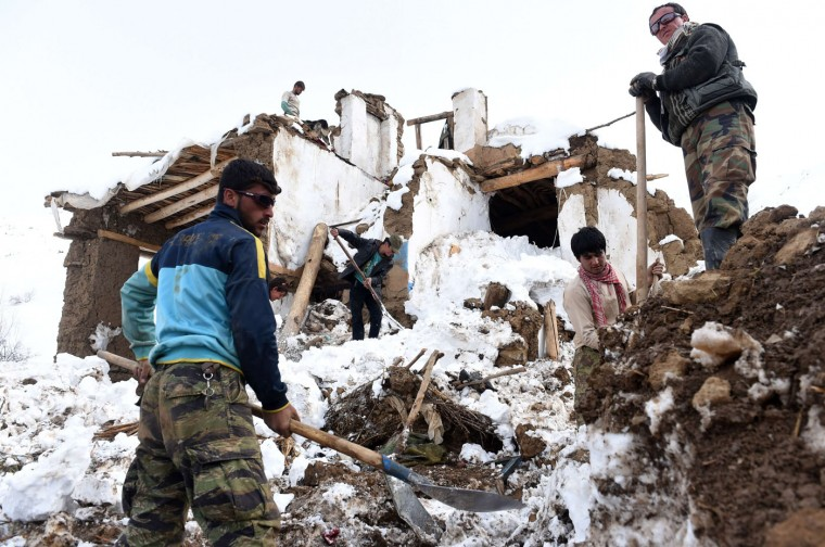 Afghan survivors of an avalanche search their destroyed houses in the Abdullah Khil village of the Dara district of Panjshir province, north of Kabul on March 1, 2015. Afghan President Ashraf Ghani February 28 pledged to set up a relief fund for the victims of avalanches that claimed over 280 lives, and called for international help with the relief effort. (Shah Marai/AFP/Getty Images)