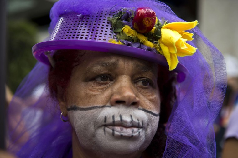 A woman takes part in a march along Paulista Avenue in Sao Paulo, Brazil, on March 8, 2015 in celebration of the International Women's Day. (Nelson Almeida/AFP/Getty Images)