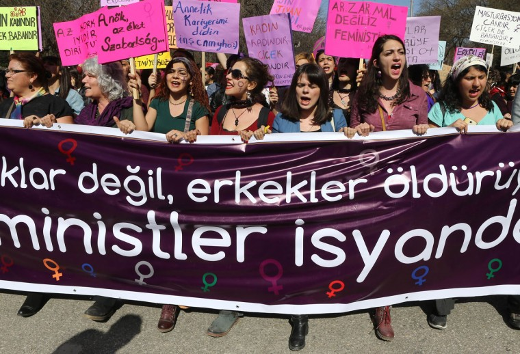 "Turkish women shout slogans during a protest on International Women's Day in Ankara on March 8, 2015. Banner reads: ""Men kill women, not streets!"" (Adem Altan/AFP/Getty Images)"