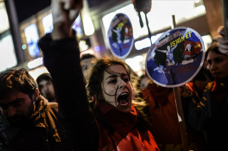 A Turkish woman shouts slogans on March 8, 2015 as she tries to cross a police cordon to reach Taksim square during a rally on Istiklal avenue in Istanbul to mark International Women's Day. (Bulent Kilic/AFP/Getty Images)