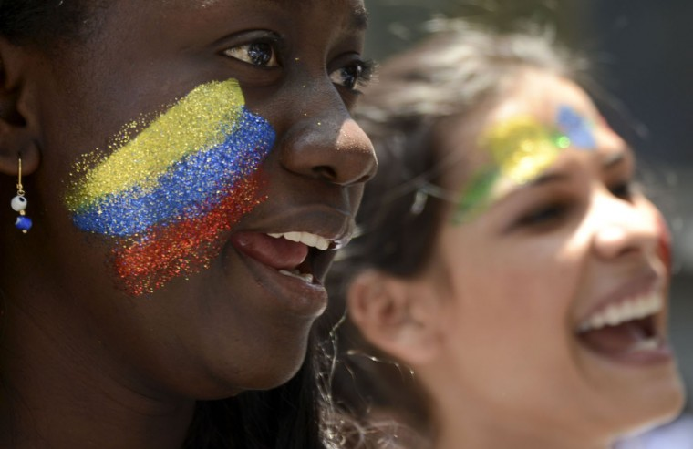 "Colombian women attend ""The March for Life"" in Medellin, Antioquia department Colombia, on International Women's Day on March 8, 2015, with a call to defeat hatred and keep society together in peace. (Raul Arboleda/AFP/Getty Images)"