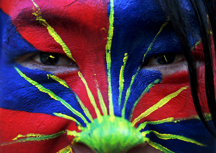 A Tibetan exile poses for a photograph during a protest in the Indian capital New Delhi on Tuesday. Scores of Tibetan protesters shouted independence slogans and waved anti-China banners in New Delhi to commemorate the anniversary of the 1959 uprising against Chinese rule. In Nepal, which is also home to thousands of Tibetan exiles, activists sang songs and made offerings to a portrait of the Dalai Lama as part of the commemorations. (Chandan Khanna/AFP/Getty Images)