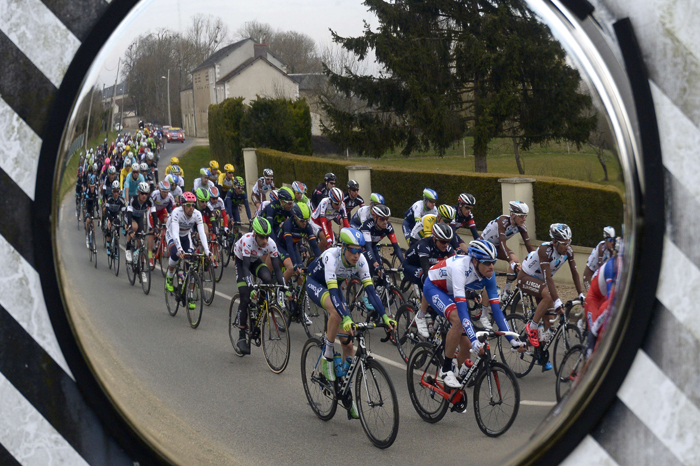 The pack is reflected in a road mirror during the second stage of the 73rd edition of the Paris-Nice cycling race, between the Beauval zoo in Saint-Aignan and Saint-Amand-Montrond, on Tuesday. (LIONEL BONAVENTURE/AFP/Getty Images)