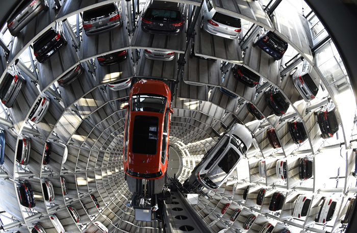 A Passatand a Golf are pictured inside the so-called cat towers of car manufacturer Volkswagen AG at the company's assembly plant in Wolfsburg, Germany, on Tuesday. (TOBIAS SCHWARZ/AFP/Getty Images)