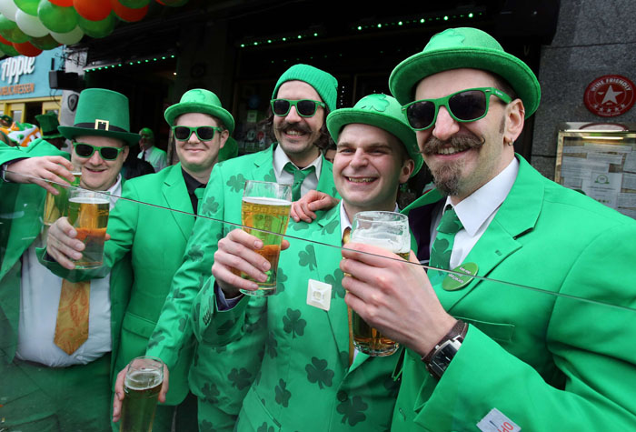 Revelers pose for pictures as they take part in the St Patrick's Day Parade in Dublin on Tuesday. (PAUL FAITH/AFP/Getty Images)