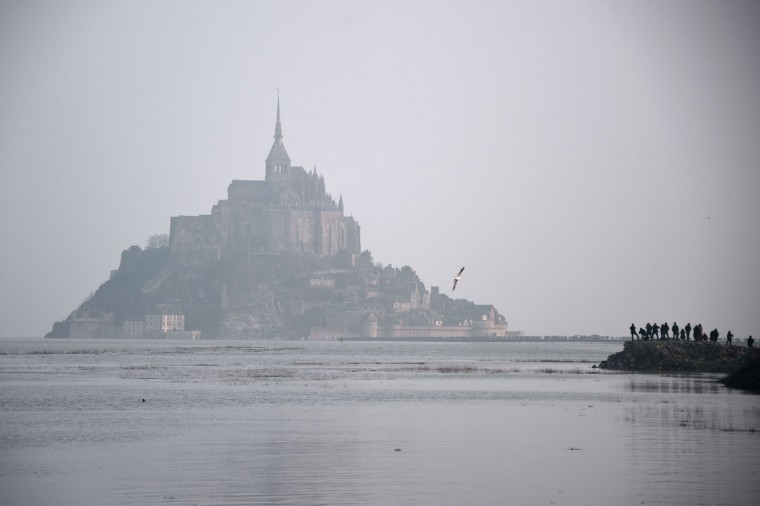 "Mont-Saint-Michel is surrounded by the sea during high tide on March 20, 2015. A ""supertide"" is expected on March 21 that will affect coastlines around the North Sea, the English Channel and to a lesser extent in the Mediterranean. The world-famous Mont Saint-Michel on France's northern coast is braced for an especially big tide, with a difference between high and low tide of 14.15 meters. (Damien Meyer/AFP-Getty Images)"