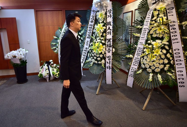 Singapore's ambassador to Seoul, Yip Wei Kiat, walks past wreaths for the late Singaporean former leader Lee Kuan Yew at the Singapore embassy in Seoul on March 23, 2015. South Korean President Park Geun-Hye expressed her deep sorrow over the death of Singapore's first prime minister Lee Kuan Yew, one of the towering figures of post-colonial Asian politics, who died at the age of 91 on March 23 in Singapore. (AFP Photo/Jung Yeon-je)