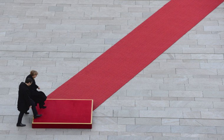 German Chancellor Angela Merkel and Greek Prime Minister Alexis Tsipras attend a welcomiing ceremony at the chancellery in Berlin, on Monday. (JOHN MACDOUGALL/AFP/Getty Images)