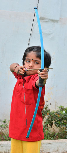 Two-year-old Indian archer Dolly Shivani Cherukuri takes aim during a world record target attempt at The Volga Archery Academy in Vijayawada some 250kms south-east of Hyderabad on Tuesday. Groomed from birth to be an archery champion after the tragic death of her older siblings, Shivani set a new national record, according to the India Book of Records. (STRSTRDEL/AFP/Getty Images)