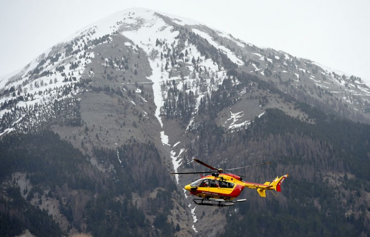 A helicopter of civil security services is seen in Seyne, south-eastern France, on Tuesday near the site where a Germanwings Airbus A320 crashed in the French Alps. A German airliner crashed near a ski resort in the French Alps on Tuesday killing all 150 people on board, in the worst plane disaster in mainland France in four decades. (CHRISTINE POUJOULAT/AFP/Getty Images)