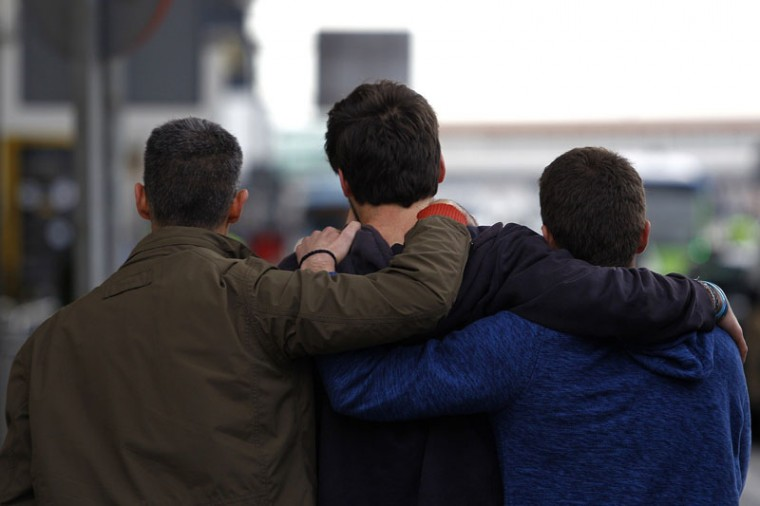 Family members of an aircrash victim embrace at Barcelona's El Prat airport on Tuesday after a Germanwings airliner crashed near a ski resort in the French Alps with all 148 people on board feared dead, officials said. The plane, travelling from the Spanish coastal city of Barcelona to the German city of Duesseldorf, issued a distress call at 10:47 a.m., sources said. (QUIQUE GARCIA/AFP/Getty Images)