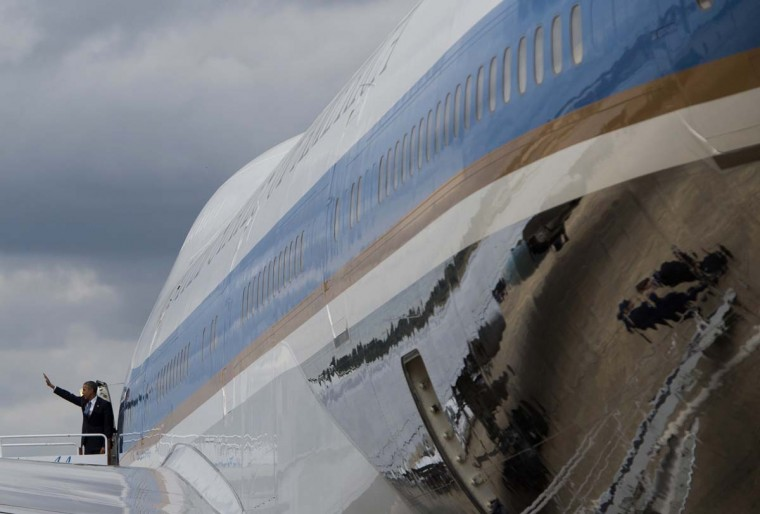 US President Barack Obama boards Air Force One prior to departing Birmingham-Shuttlesworth International Airport in Birmingham, Alabama on March 26, 2015.  || CREDIT: SAUL LOEB - AFP/GETTY IMAGES