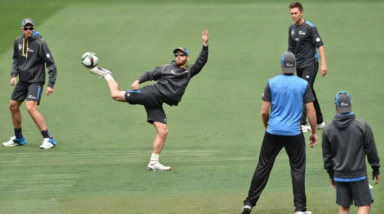 New Zealand's Kane Williamson (2L) kicks the ball while playing football during a training session at the Melbourne Cricket Ground (MCG) on March 27, 2015 ahead the 2015 Cricket World Cup final match between Australia and New Zealand in Melbourne.   || CREDIT: INDRANIL MUKHERJEE  - AFP/GETTY IMAGES