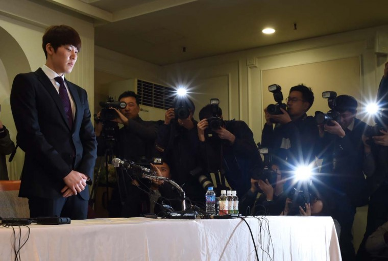 South Korean swimmer Park Tae-Hwan (L) stands before the media during a press conference in Seoul on March 27, 2015. Disgraced South Korean swim star Park Tae-Hwan made an emotional public apology over his failed doping test on March 27, fighting back tears and begging to be forgiven.  || CREDIT: ED JONES - AFP/GETTY IMAGES